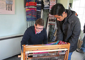 Students fro Basingstoke College of Technology trying out Saori weaving at the Whitchurch Silkmill