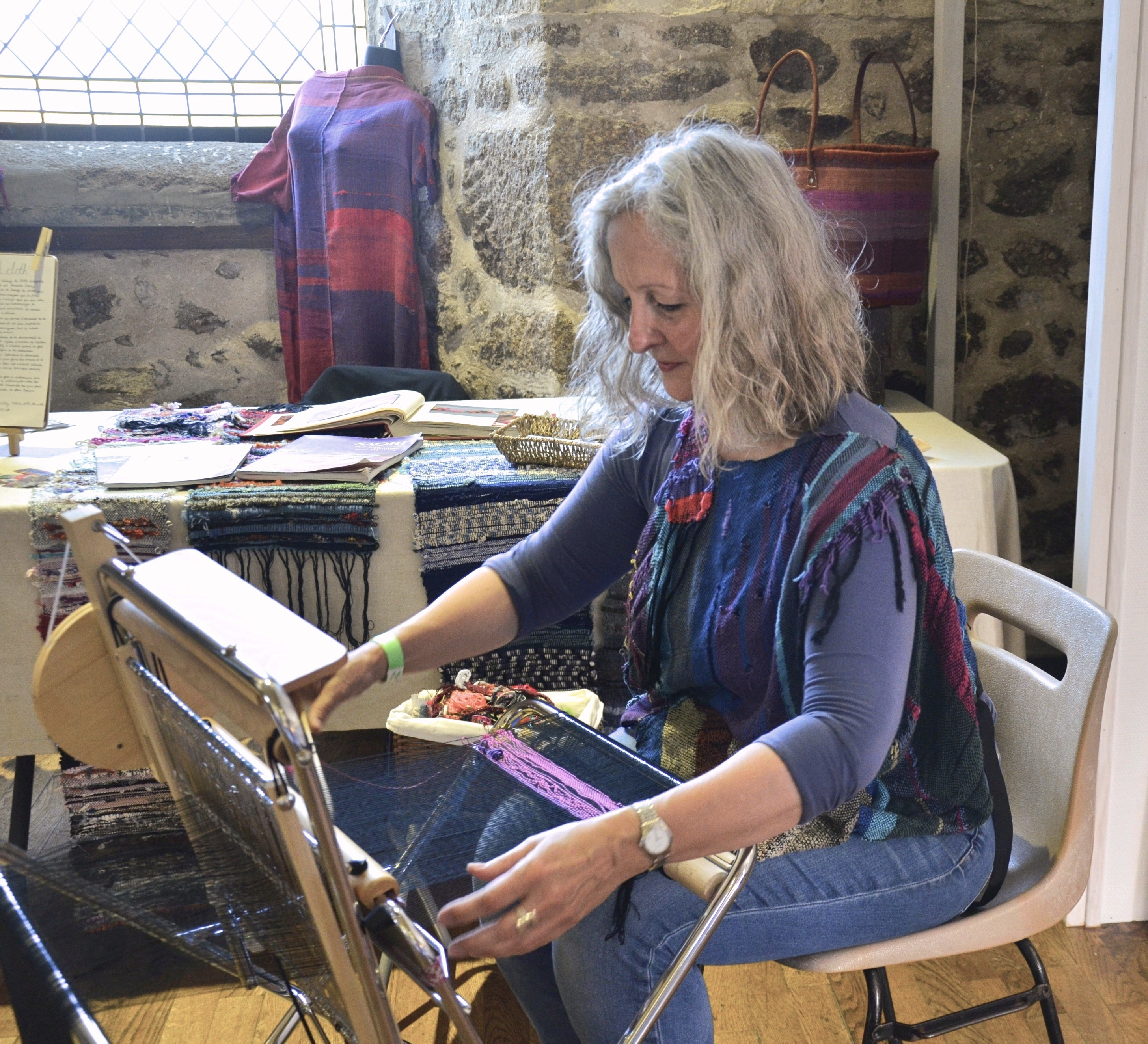 Amanda saori weaving at an art festival in Lassay-les-Chateaux, France.