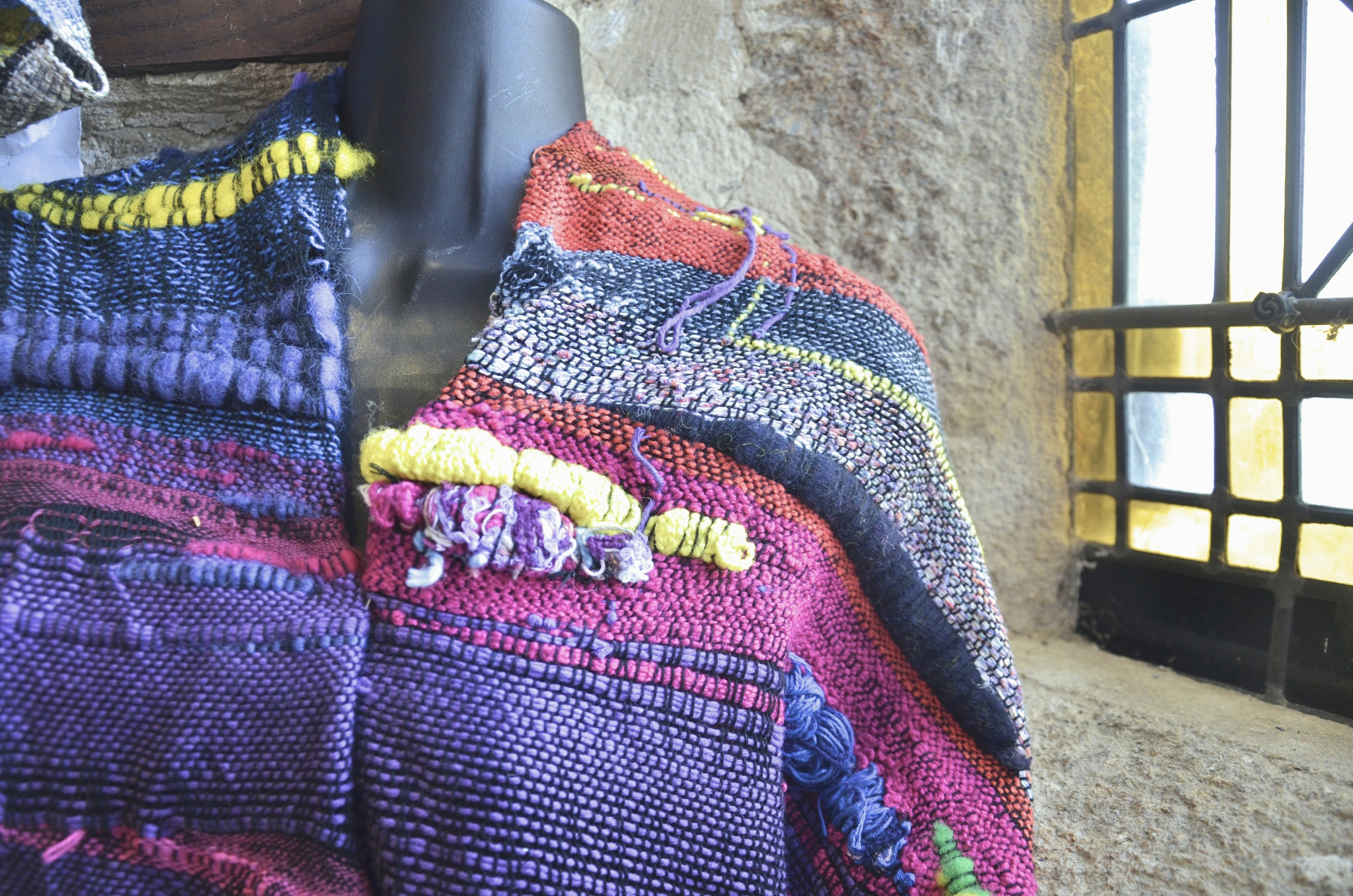 SAORI woven pink, purple and yellow jacket, made from cotton and wool fibres.