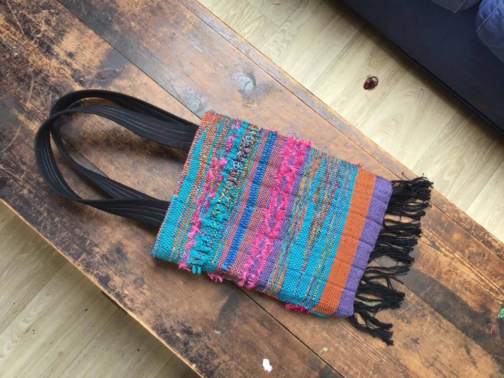Handwoven cloth bag on wooden table