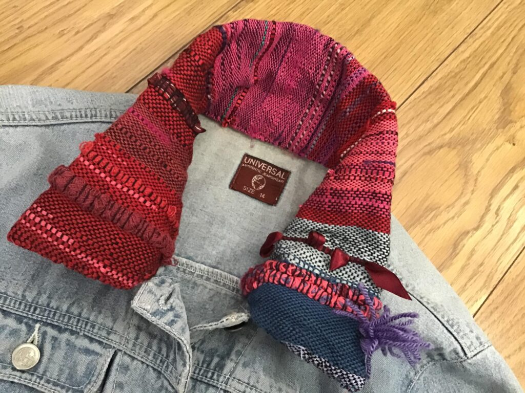 Pale blue denim jacket with red handwoven collar