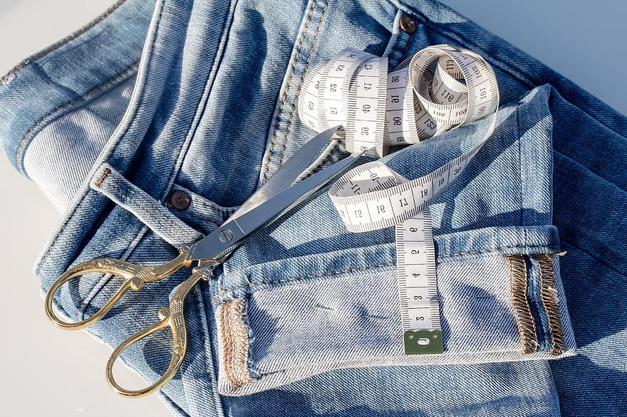 Scissors and measuring tape on jeans