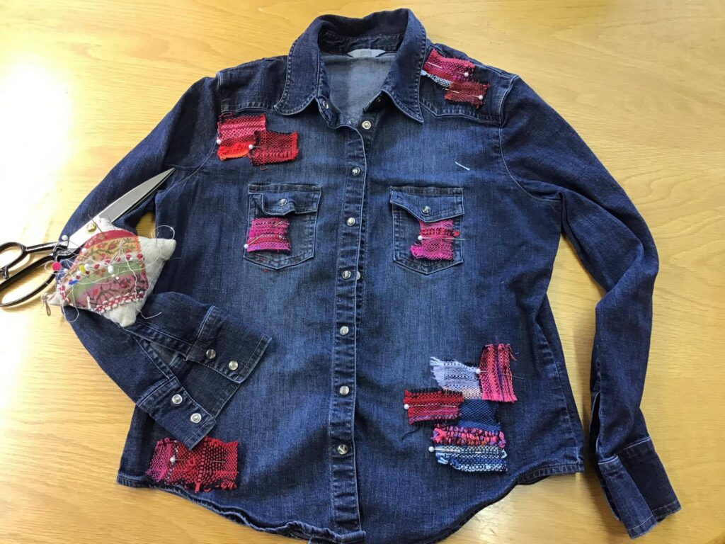 Blue denim shirt patched with red and pink cloth